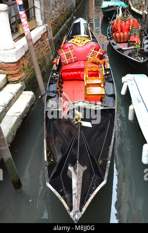 Unmanned Venetian Gondolas in a side canal off The Grand Canal, Venice, Italy - Stock Photo