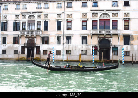 Gondolas and Gondoliers on The Grand Canal, Venice, Italy - Stock Photo