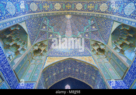Details of main entrance portal of the mosque in Chaharbagh madraseh, famous for its masterpiece tiled patterns - Stock Photo