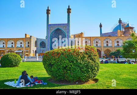 ISFAHAN, IRAN - OCTOBER 20, 2017: Park in Naqsh-e Jahan Square is nice place for picnic with a view on beautiful - Stock Photo