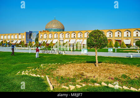 ISFAHAN, IRAN - OCTOBER 20, 2017: Naqsh-e Jahan Square is one of the most beautiful places in city, it attracts - Stock Photo