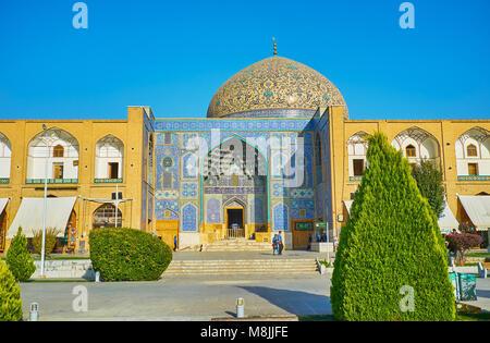 ISFAHAN, IRAN - OCTOBER 20, 2017: The scenic Naqsh-e Jahan Square with beautiful portal and dome of Sheikh Lotfollah - Stock Photo