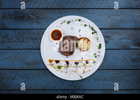 Steak pepper from veal with grilled vegetables. - Stock Photo