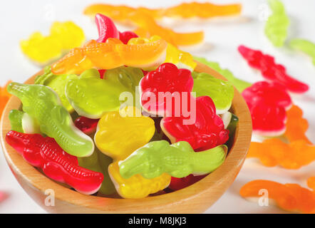 bowl of colorful gummy candies in the shape of animals - close up - Stock Photo