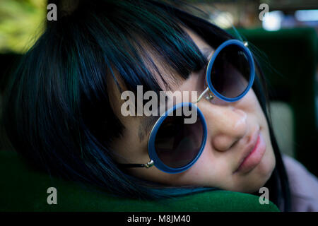 Girl with sunglasses sleeping on the bus - Stock Photo