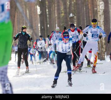 KAZAN, RUSSIA - March, 2018: Male skiers running skiing in winter, ski marathon - Stock Photo