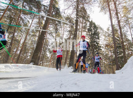 KAZAN, RUSSIA - March, 2018: professional winter ski race with many athletes running one after the other, wide angle - Stock Photo