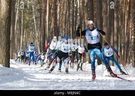 KAZAN, RUSSIA - March, 2018: professional sportsmen -athletes skiers running ski marathon - Stock Photo