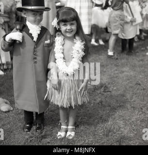 1950s, historical picture of two children standing outside at a fete together taking part in a fancy dress competition...the - Stock Photo