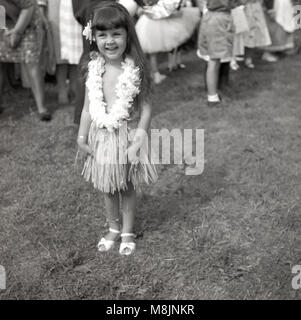 1950s, historical picture, a happy little girl standing an outside fete smiling, proudly wearing her costume of - Stock Photo