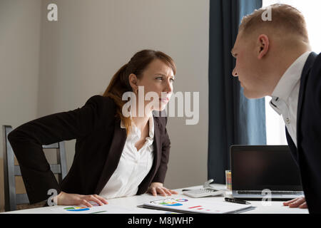 Office conflict between man and woman. Competition between men and women. Feminism concept - Stock Photo