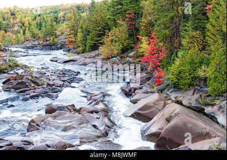 the Onaping river in northern Ontario in the fall - Stock Photo