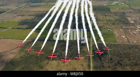 the Red Arrows (RAF Aerobatic Team)  overflying Ontario, Canada - Stock Photo