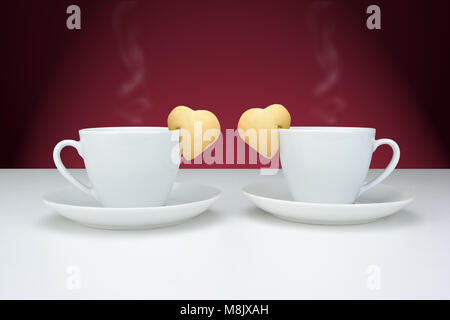 Cups of black coffee with heart shaped cookies - Stock Photo