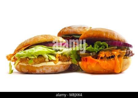 Big fresh tasty three burgers isolated on white background - Stock Photo