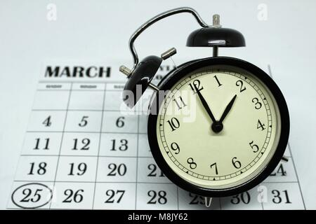 Daylight Savings Spring Forward sunday at 2:00 a.m. March 25 date indicated in the calendar. - Stock Photo