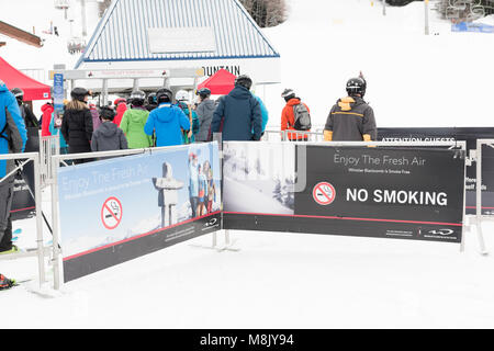 People in line for the chairlift at Whistler Blackcomb ski resort. - Stock Photo