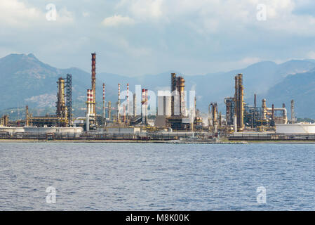 Industrial zone in Milazzo town on Sicily seen from the sea, Italy - Stock Photo