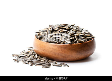 Sunflower  seeds in wooden bowl isolated on white - Stock Photo