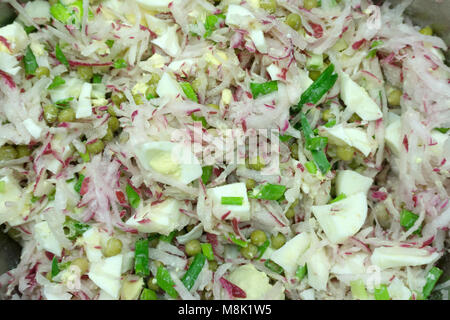 Mixed salad leaves frisee, radicchio and lamb's lettuce. Background, texture - Stock Photo
