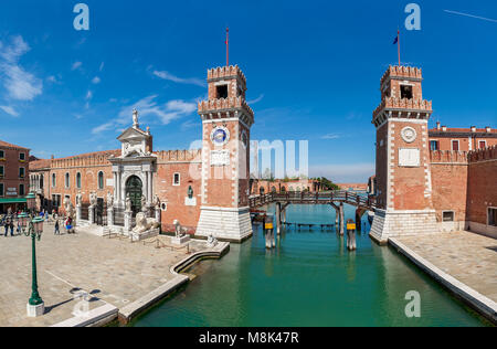 View of small piazza and towers off famous Venetian Arsenal - complex of former shipyards and armories, currently - Stock Photo