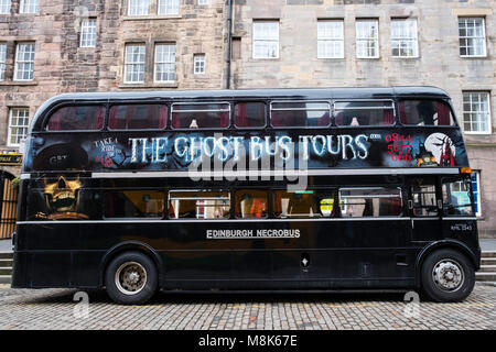 The Ghost Bus Tours double decker bus on the Royal Mile in Edinburgh, Scotland, United Kingdom - Stock Photo