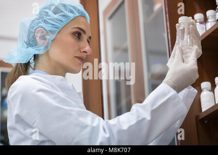 Woman chemist finding the perfect substance during experimental  - Stock Photo