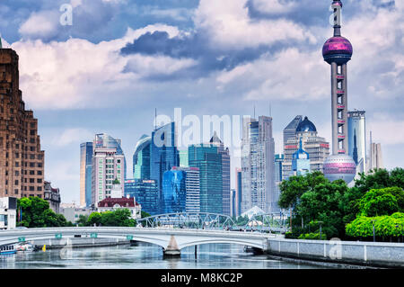 July 15, 2015.  Shanghai, China. The Waibaidu (garden) and Huqiu Road bridges over the Wusong River (Suzhou Creek) with the modern buildings of Lujiaz Stock Photo