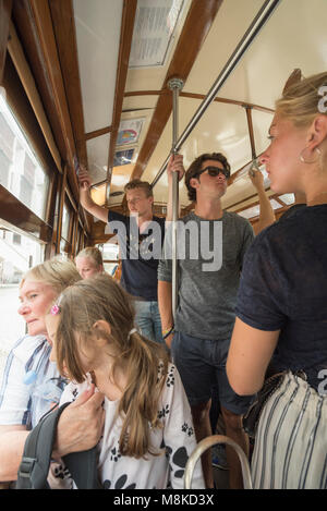 Passengers on circular tram route 12, which starts and finishes at Praça da Figueira, Lisbon, Portugal - Stock Photo
