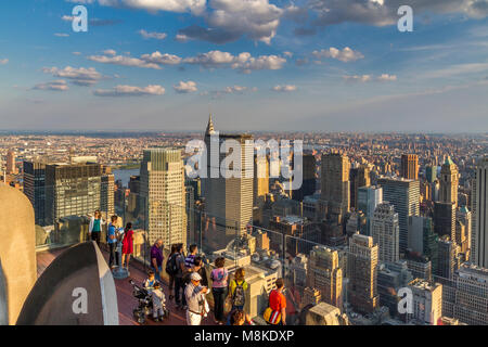 Late afternoon sunshine on Manhattan from The Top Of The Rock Observation Deck on the top Rockefeller Center Building - Stock Photo