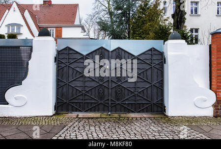 Berlin,Grunewald,Building detail of  Large mansion. Grand wrought iron gate entrance of Historic old suburban house. - Stock Photo
