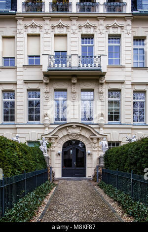 Berlin,Grunewald, Large suburban mansion entrance with elegant arched door,wrought iron balconies,sculptural details,cupid - Stock Photo