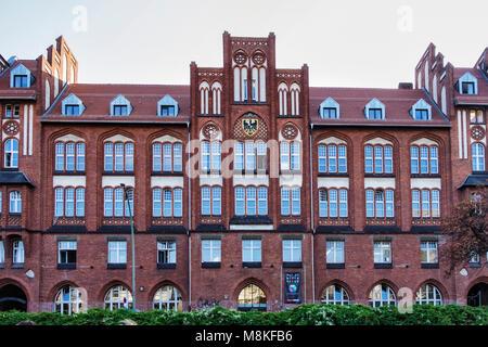 Berlin Kreuzberg. Old Post Office building exterior with clinker brick façade, gables, arched windows & decorative - Stock Photo
