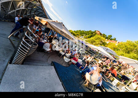 Graz, Styria / Austria - 07 09 2016 : Mur island bridge in Graz full of people enjoying a concert sunny evening - Stock Photo