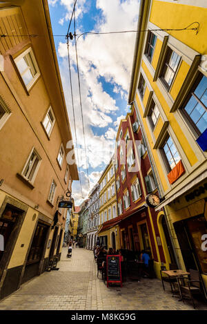 Graz, Styria / Austria - 07 09 2016 : One of colorful alleys in Graz city with historical buildings and restaurants - Stock Photo