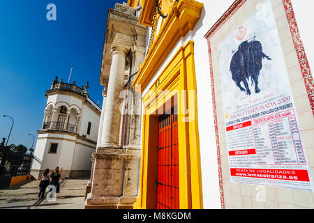 Seville, Andalusia, Spain : Tourists walk past the Maestranza bullring in the Paseo de Colón st. in Arenal district - Stock Photo