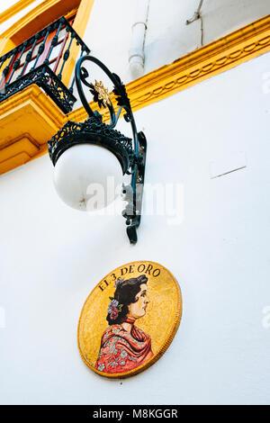 Seville, Andalusia, Spain : Sign of El 3 de Oro bar and restaurant in Santa Cruz district. - Stock Photo