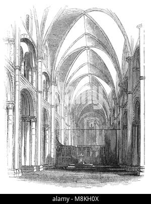 The Nave of Christchurch Priory, established in 1094 is an ecclesiastical parish and former priory church in Christchurch - Stock Photo