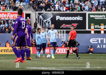 NYCFC vs Orlando City SC action at Yankee Stadium on 17th March 2018. NYCFC won 2-0. Captain Maxime Chanot (4) talks - Stock Photo