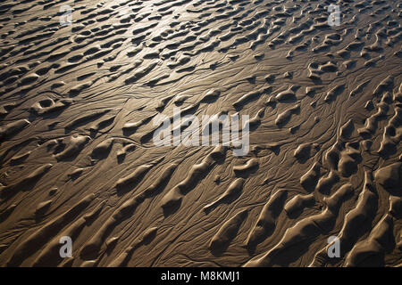 Patterns left by the ebbing tide in estuarine sand, near Jenny Brown's Point, Morecambe Bay, northwest england UK - Stock Photo