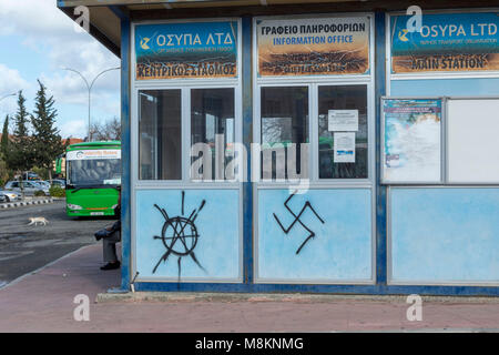 Nazi insignia on the side of the Karavella bus station, Paphos, Cyprus, Mediterranean - Stock Photo