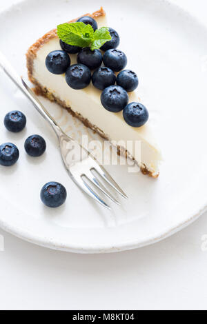 New York Cheesecake With Fresh Blueberries And Mint On White Background, selective focus. Blueberry Cheesecake - Stock Photo