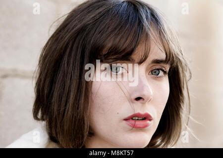Portrait of a beautiful, fair skinned woman with hazel eyes, brown hair, and  red lipstick, - Stock Photo