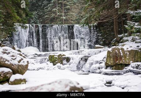 Wild Waterfall, known as Dziki Wodospad, in beautiful scenery of Karkonosze Mountains in Karpacz, Poland, photographed - Stock Photo