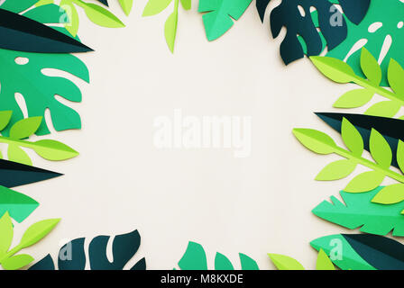 Summer Tropical Paper Cut leaves, Frame. Exotic summertime. Space for text. Beautiful dark green jungle floral background. - Stock Photo