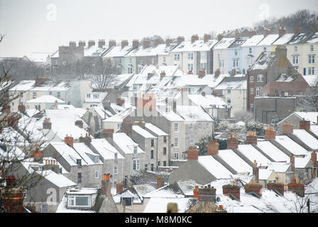 Portland, Dorset. 18th March 2018 - The snowy village of Fortuneswell in what is very rare weather on the Isle of - Stock Photo