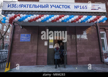 Moscow, Moscow, Russia. 18th Mar, 2018. Women exit a polling station during the voting day of the presidential russian - Stock Photo