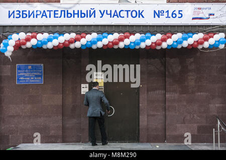 Moscow, Moscow, Russia. 18th Mar, 2018. Man enters to a polling station during the voting day of the presidential - Stock Photo