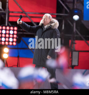 Moscow, Russia. 18th Mar, 2018. Incumbent Russian President Vladimir Putin gestures to people at an occasion in - Stock Photo