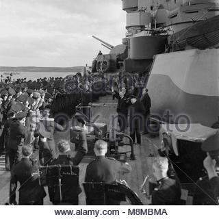 The Prime Ministers Visit To the Home Fleet, at Scapa Flow. 11 October 1942. The ship's company of HMS RODNEY, giving - Stock Photo